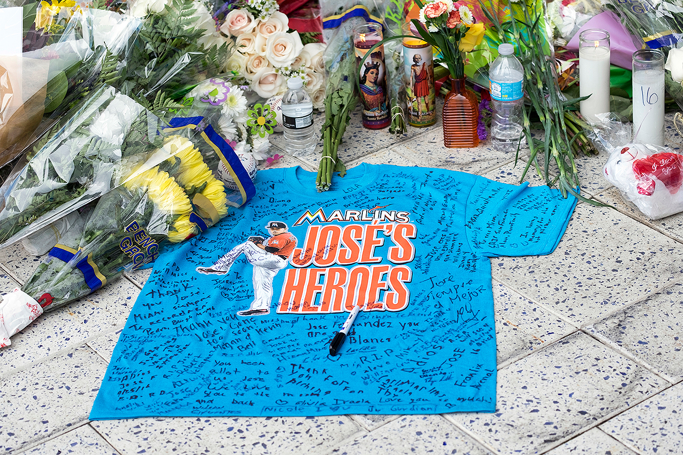 A remembrance shirt at a makeshift memorial in honor of Jose Fernandez sits outside Marlins Park on Sunday, Sept. 25, 2016 in Miami.