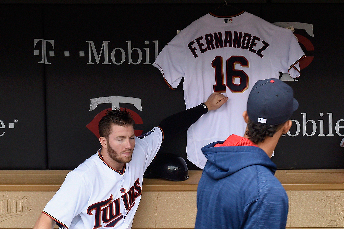 Minnesota Twins outfielder Robbie Grossman touches a jersey hung in the dugout in remembrance of Jose Fernandez during a game against the Seattle Mariners on Sunday, Sept. 25, 2016 at Target Field in Minneapolis, Minn.