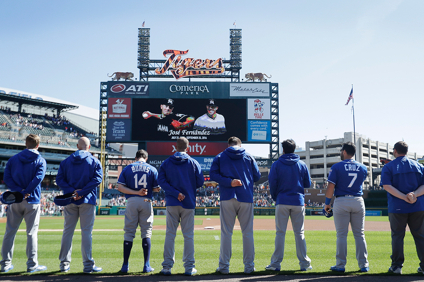 Members of the Royals stand during a moment of silence for Jose Fernandez before Sunday's game against the Tigers.