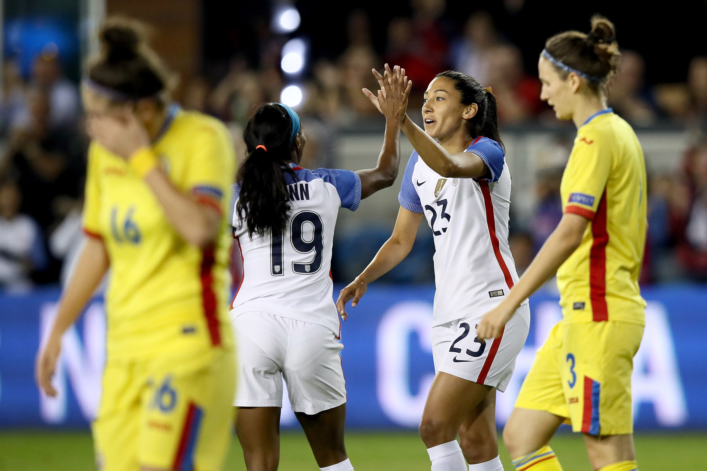 Crystal Dunn congratulates Christen Press on one of her three goals as the USA handled Romania with ease, winning 8-1 at Avaya Stadium in San Jose, California.