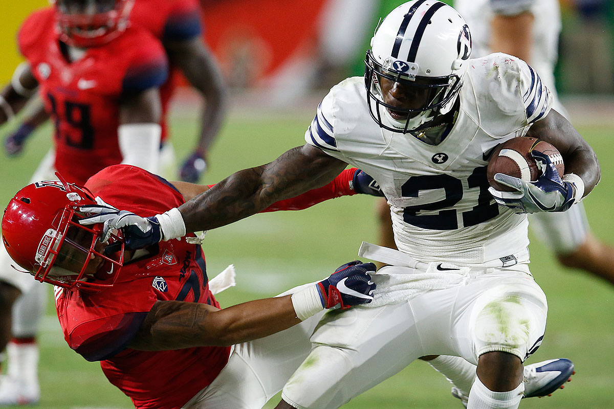 """Williams is a 6' 2"""", 215-pound battering ram—when he's healthy. He ran for 286 yards and five touchdowns against Toledo in September, and with a few weeks to fully recover from the ankle injury that hindered him in the second half of the season, he should once again be the focal point of the Cougars' offesne against Wyoming, which failed to crack the top 100 in rush defense."""