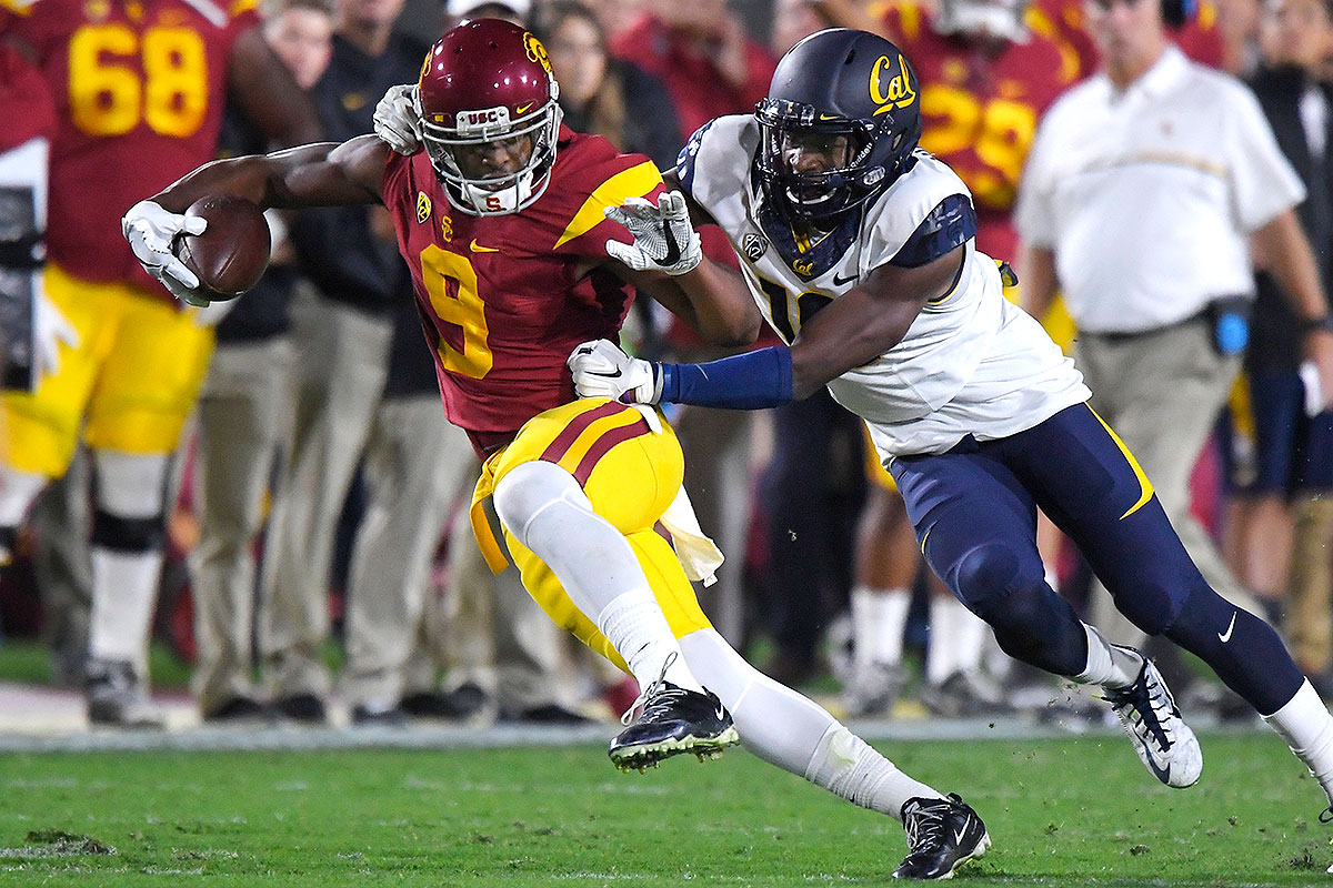 """The junior receiver has said he may stay in school if USC cornerback Adoree' Jackson opts to do the same. At least in terms of his body type and build, Smith-Schuster is ready for the next level. He's a strong, physical receiver at 6' 2"""", 220 pounds, and he finishes plays with effort. He had 1,454 receiving yards last year; that number dropped to 781 this season."""