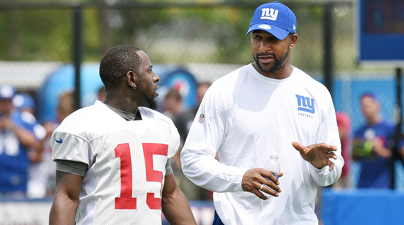 Since rejoining the Giants in 2014, Tyree (right) has become the mentor he needed often in his playing days.