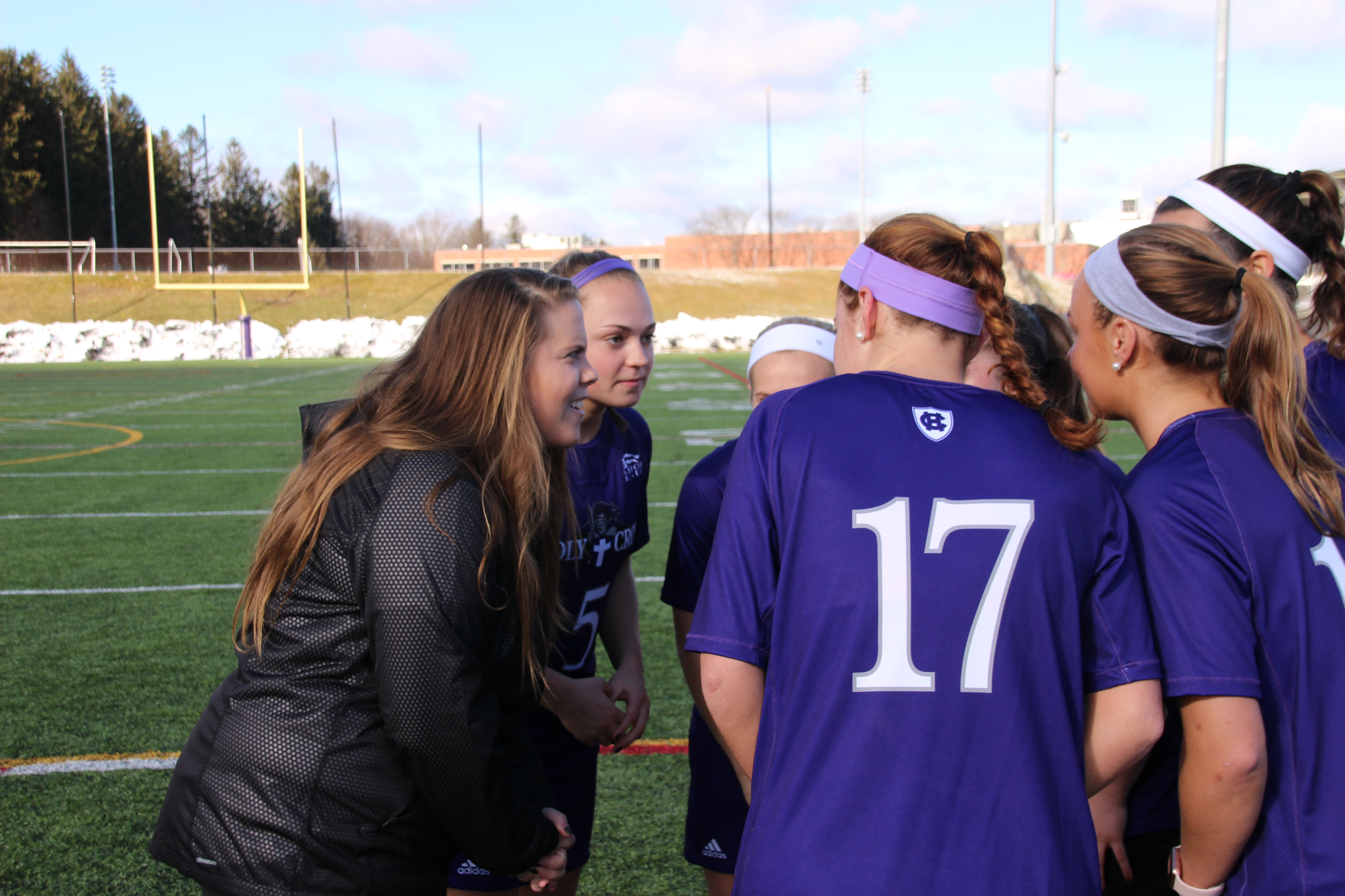 Coach Belichick chats with her players at a recent practice.