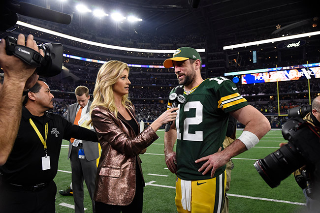 Andrews at her happiest: Interviewing Packers QB Aaron Rodgers post-game.