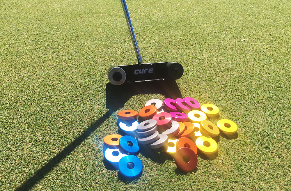 The Cure putter line features adjustable weights for a fully customized putter.