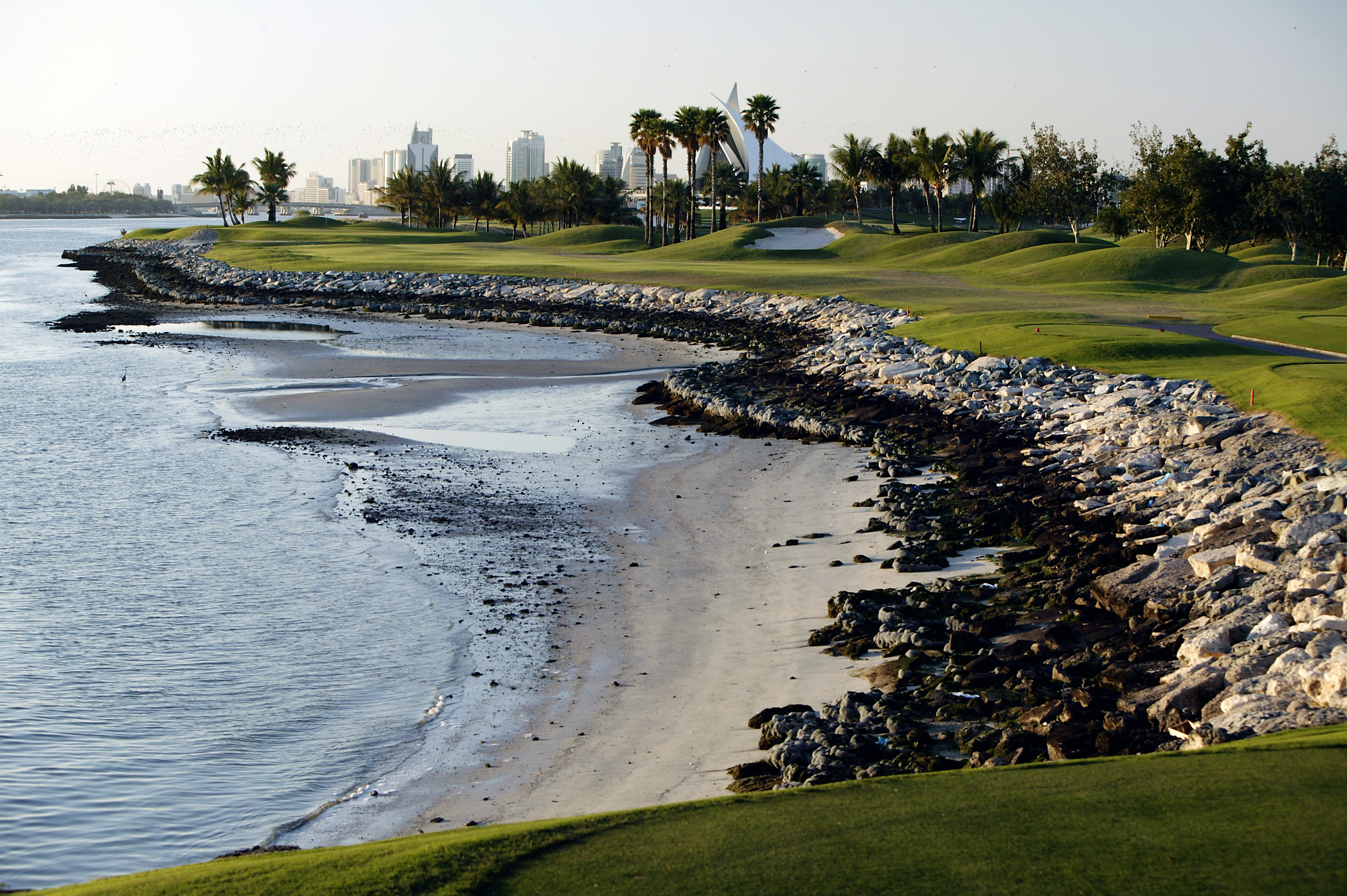 Adjacent to the Park Hyatt Dubai, Dubai Creek furnishes a superior par-3 course—Rory McIlroy has sampled it—and a totally fun championship 18. The finish is world-class, with the 354-yard 17th and the 421-yard 18th a pair of riveting par-4s that skirt the wide, boat-filled Dubai Creek. Behind the 18th green is one of golf's most distinctive clubhouses, which resembles the sails of an Arabic dhow.