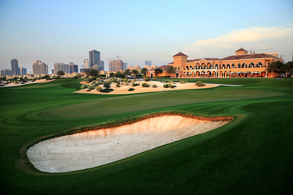 """The club's namesake designer, Ernie Els, is nicknamed, """"The Big Easy."""" His 2008 design within Dubai Sports City is anything but. At 7,538 yards, it's a muscular layout even with extra-roomy fairway landing areas and you'll have acres of bright white sand to avoid, both in the form of traditional, often steep bunkers and in the vast, scrub-dotted transition areas that separate holes."""