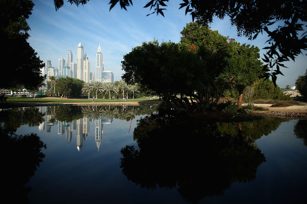 """The Middle East's first all-grass golf course dates to 1988 and it continues as the most prominent course in the region. Host to the annual Omega Dubai Desert Classic for nearly 30 years, Emirates is best recognized for its lush landscaping, desert accents and skyscraper backdrops, such as at the par-4 eighth, setting for two-time champion Rory McIlroy's """"Standing in the Hall of Fame"""" Omega watch ad."""