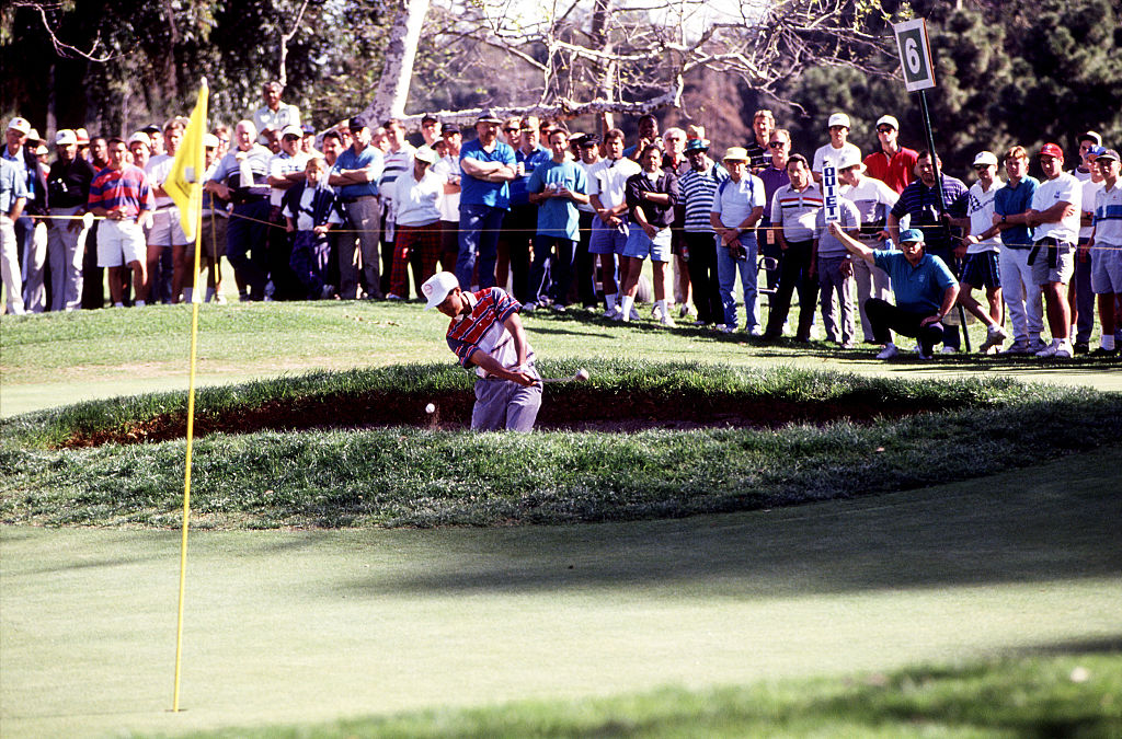 Woods hits a bunker shot at the Riviera Country Club in 1992.