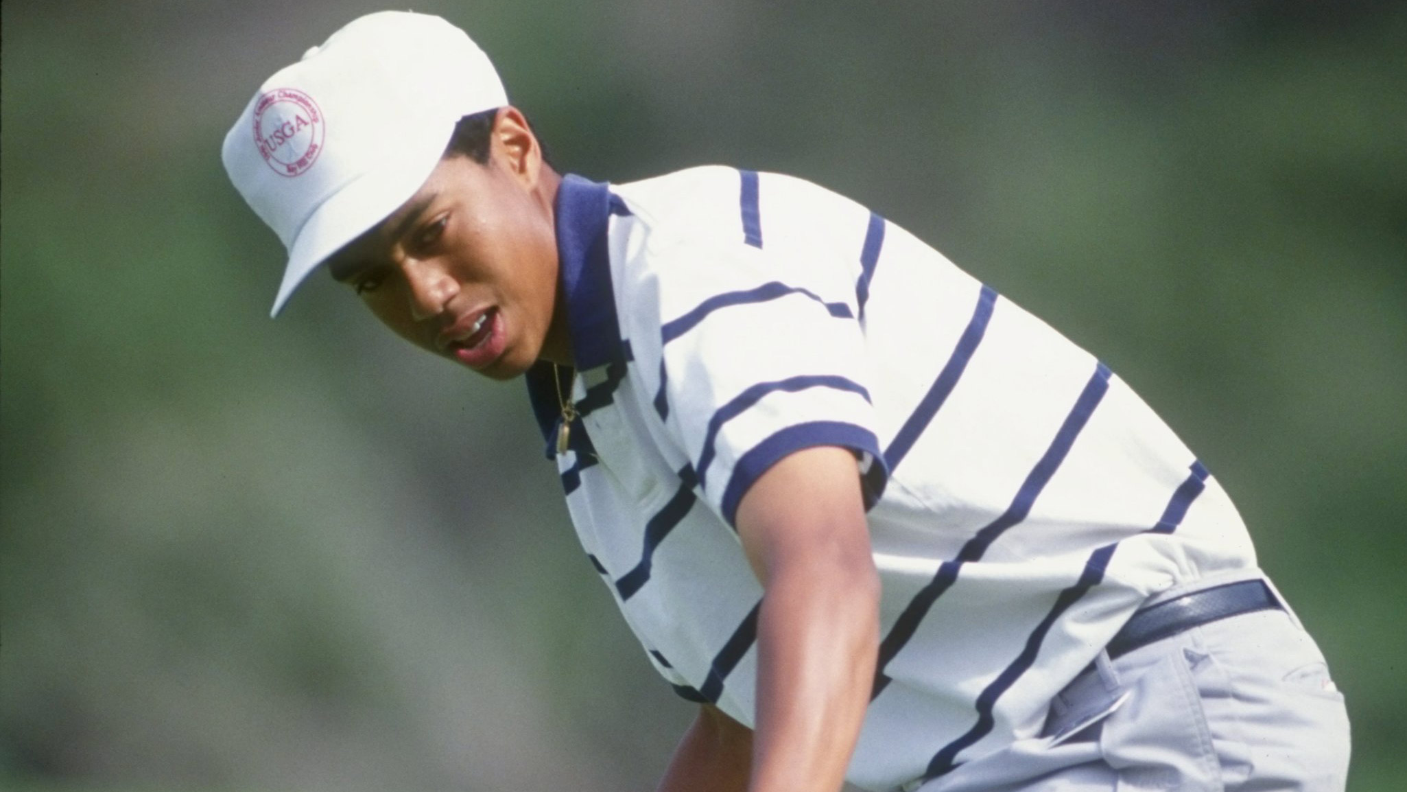 Tiger Woods reacts to his putt during the 1992 L.A. Open.