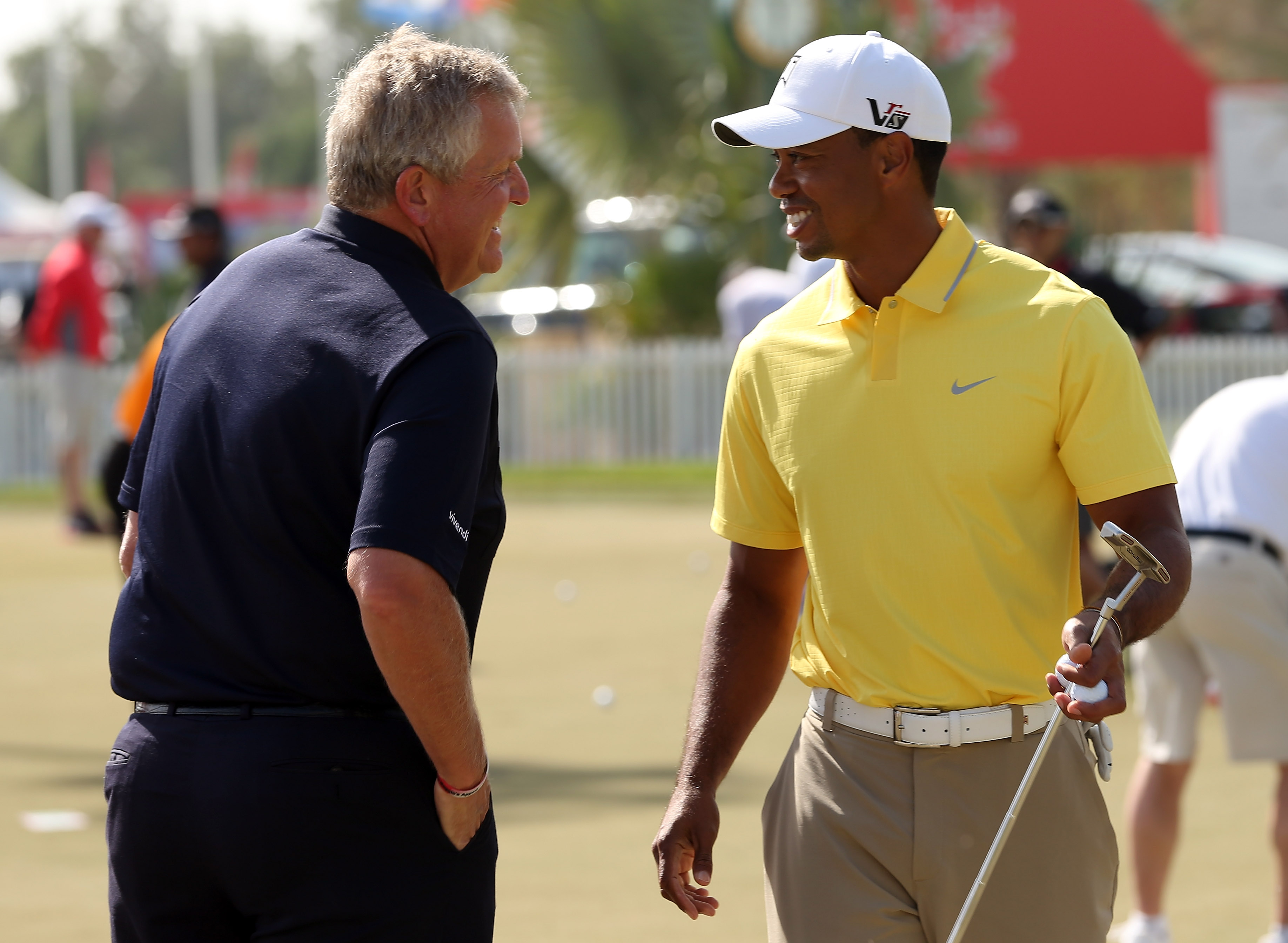 Tiger Woods chats with Colin Montgomerie during the Pro Am prior to the start of The Abu Dhabi HSBC Golf Championship on January 16, 2013