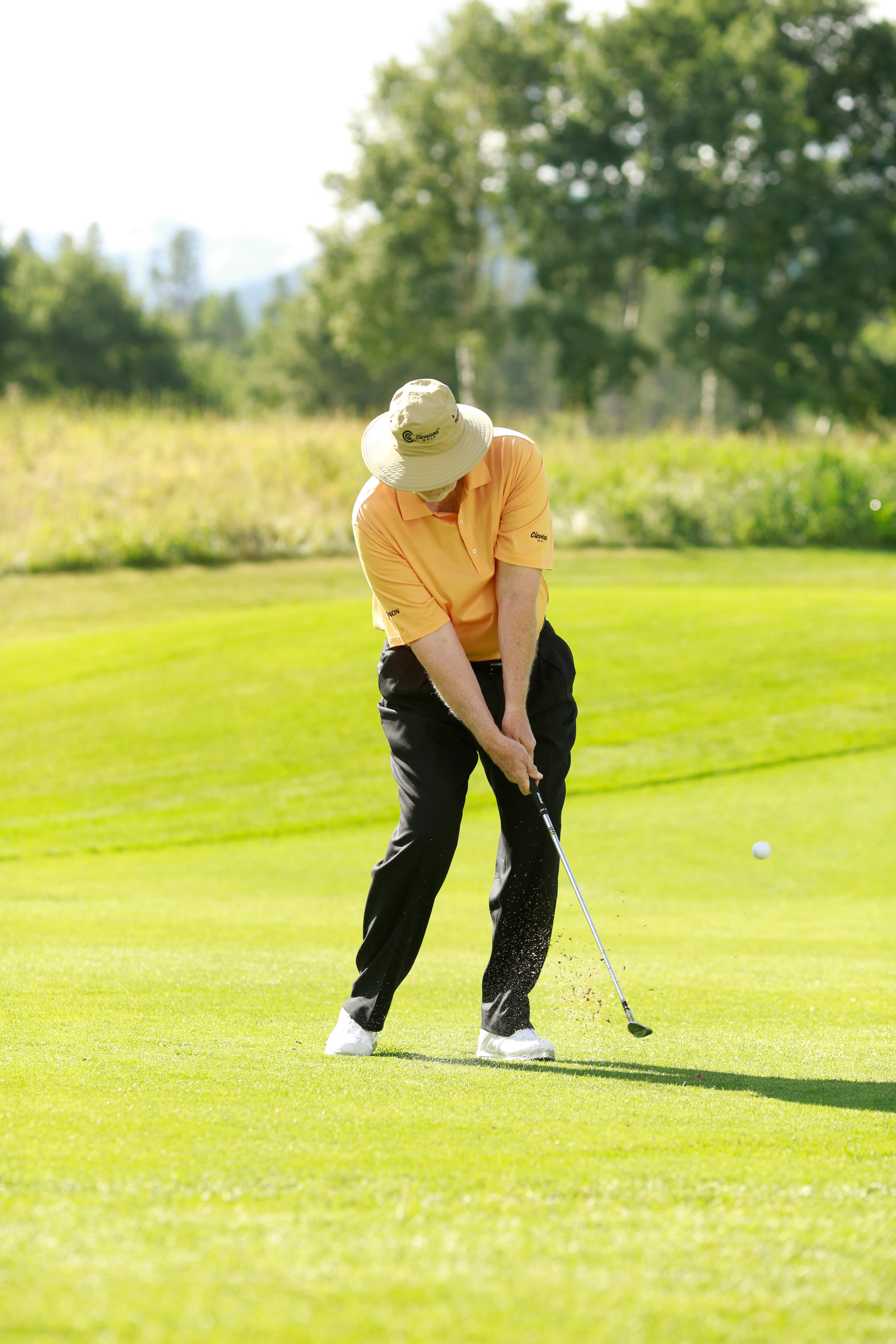 "Follow-through keys: Keep your left arm straight, accelerate smoothly and ""kiss"" the grass."