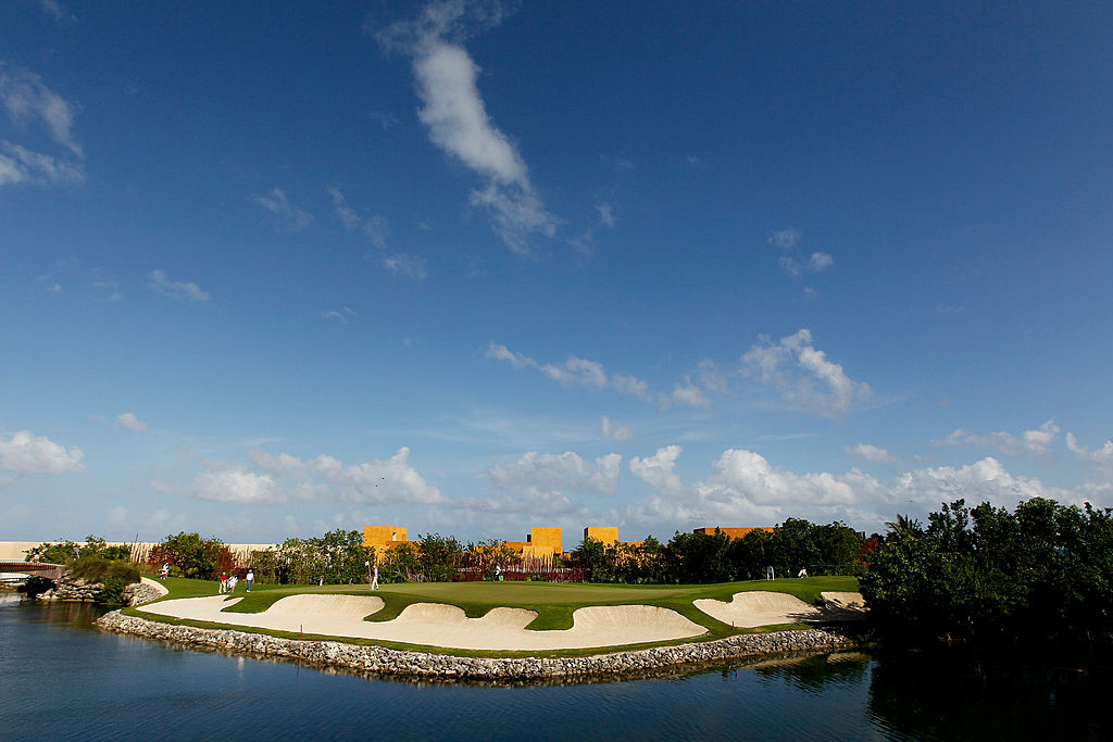 Golfers on the third green at  Riviera Maya Cancun at El Camaleon Golf Club.