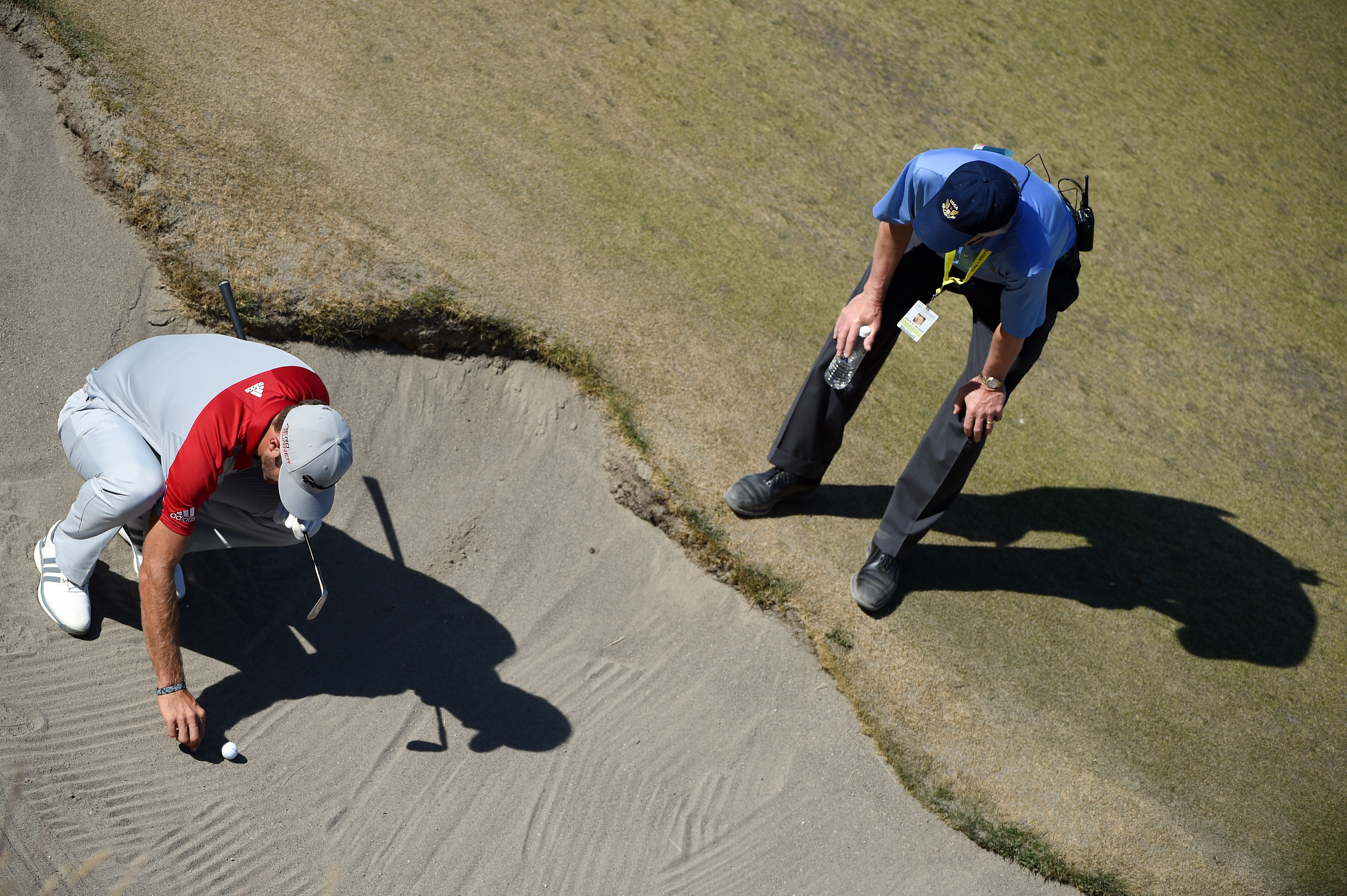 Players will be able to remove loose impediments from a bunker.