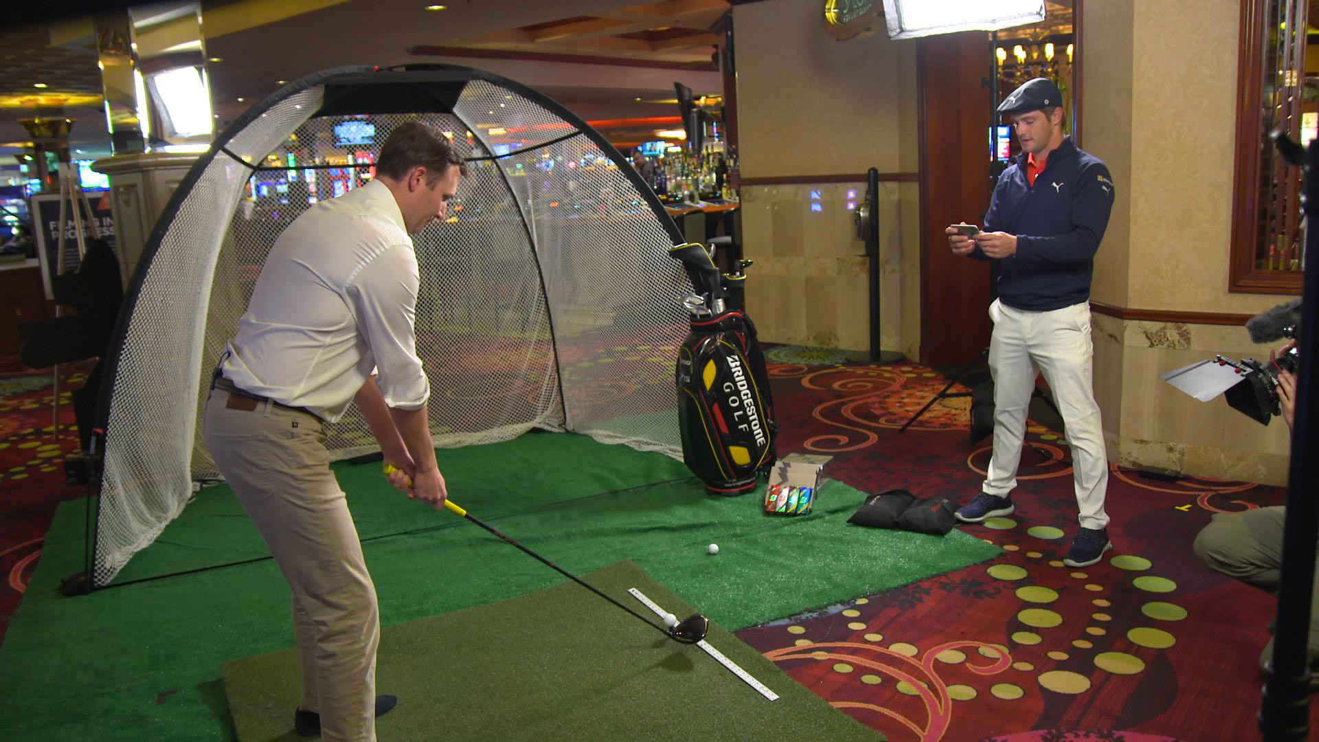 PGA Tour pro Bryson DeChambeau helps demonstrate Bridgestone's new BFIT app.