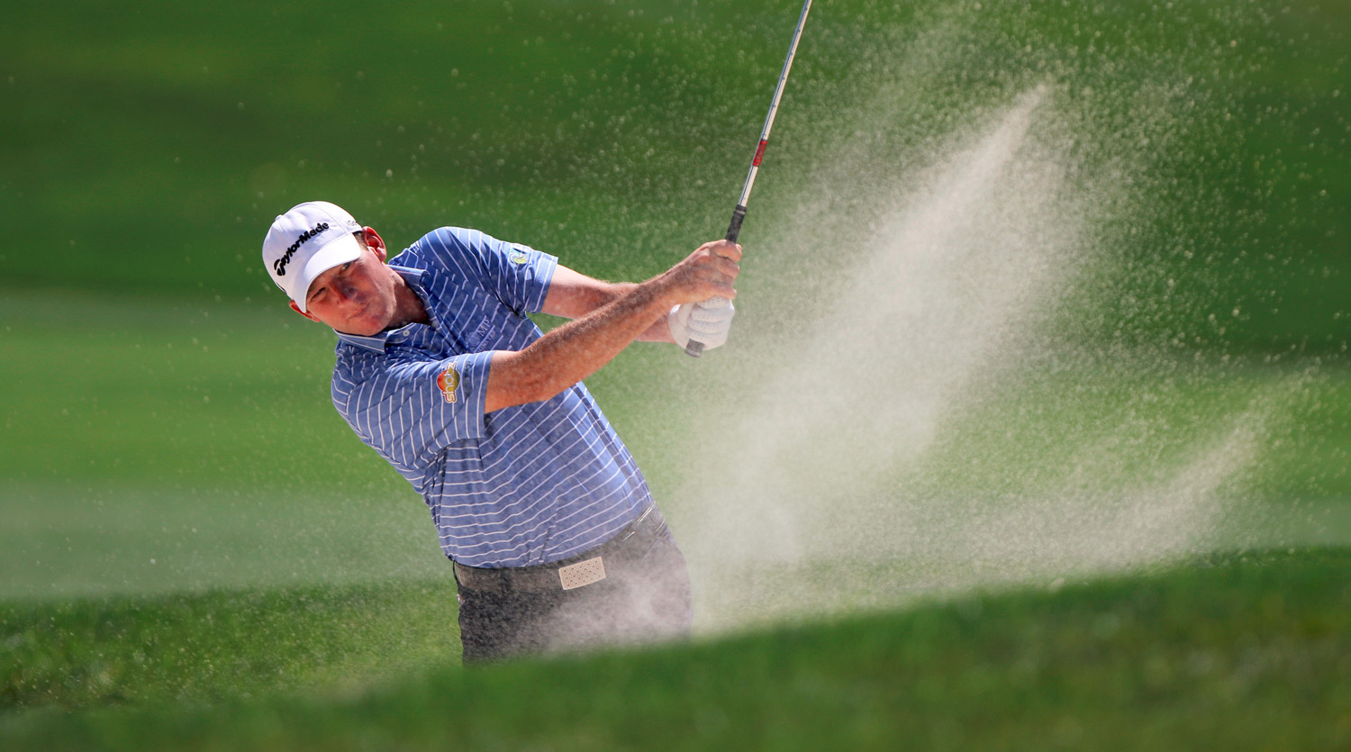 Jim Herman hits from a trap at the ninth hole during the first round of the Valspar Championship.