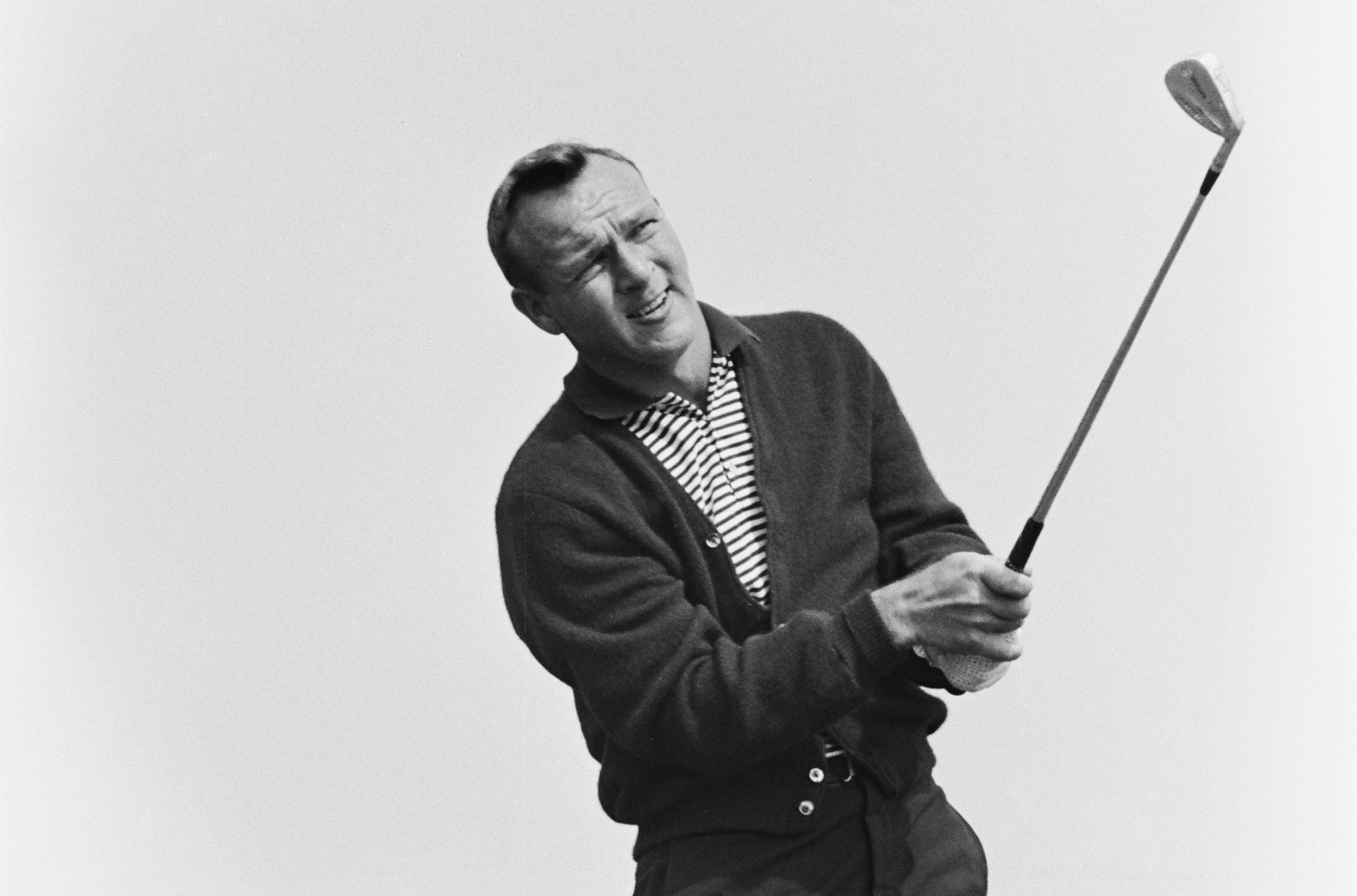 Arnold palmer sports a cardigan at the 1963 World Series of Golf.