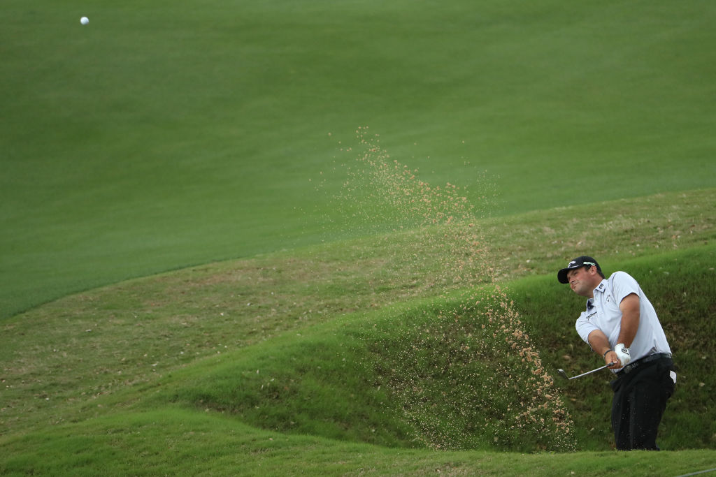 Patrick Reed plays a shot out of a bunker on the 10th hole of his match during the World Golf Championships-Dell Technologies Match Play.