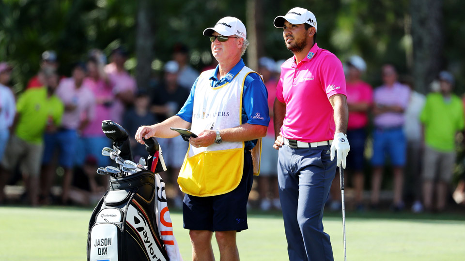 Jason Day stands next to his golf clubs on Sunday at the Players Championship.
