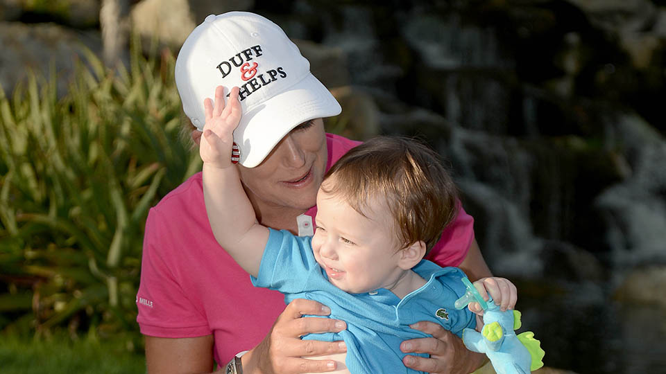 Cristie Kerr and her son Mason pose with the winners trophy after her 20 under-par victory at the 2015 KIA Classic.