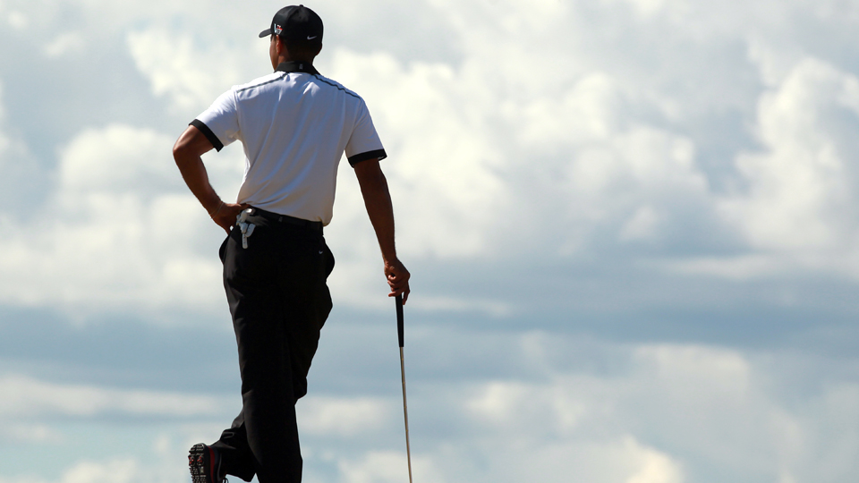 Tiger Woods stands on the fourth green during the first round of the 2013 British Open at Muirfield.