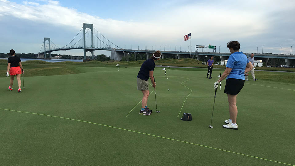 The putting challenge on the practice green at Trump Golf Links at Ferry Point.