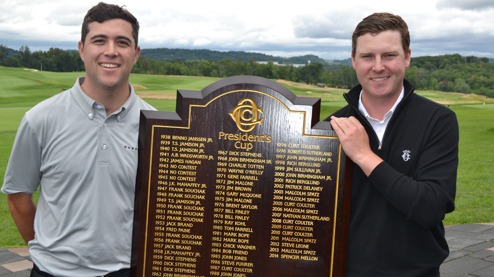 Last year's President's Cup champion Nathan Sutherland (left) stands with Oakmont head pro Devin Gee after winning in 2015.