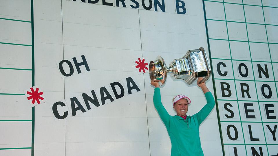 Brooke Henderson hoists her trophy after winning the 2016 KPMG Women's PGA Championship.