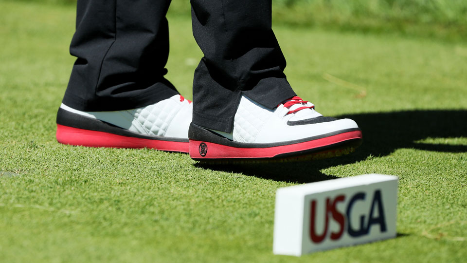 Bubba Watson shows off a pair of high-top shoes during a Tuesday practice round at Oakmont.
