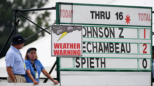 A weather delay sign is seen on the leader board during the first round of the U.S. Open at Oakmont Country Club on June 16, 2016 in Oakmont, Pennsylvania.