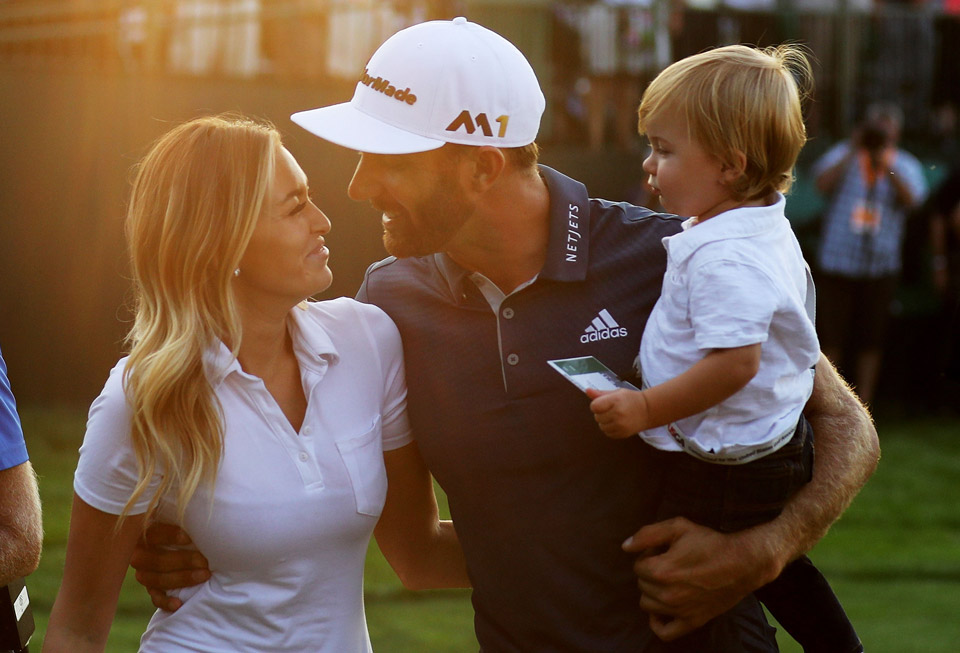Johnson and Gretzky with their son after the completion of the 2016 U.S. Open.
