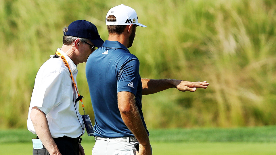 A controversial ruling by the USGA cost Dustin Johnson a stroke at the U.S. Open at Oakmont.