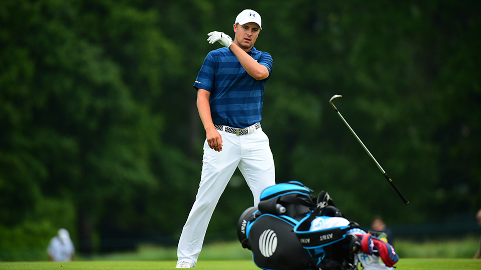 Jordan Spieth tosses his club after his second shot at the 17th hole during Round 1 of the 2016 U.S. Open.
