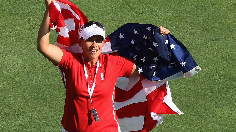 Angela Stanford celebrates on the 18th fairway after winning a Sunday singles match at the 2009 Solheim Cup.