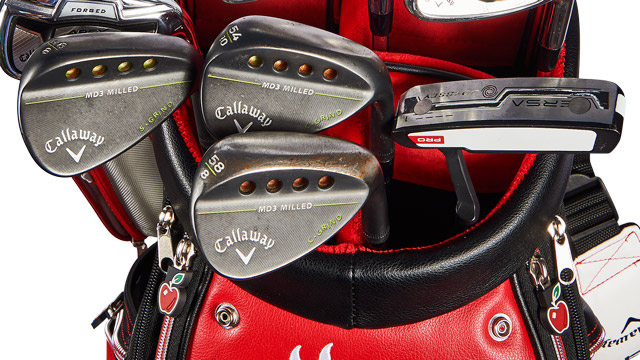 A close-up of Leishman's Callaway wedges and Odyssey putter.