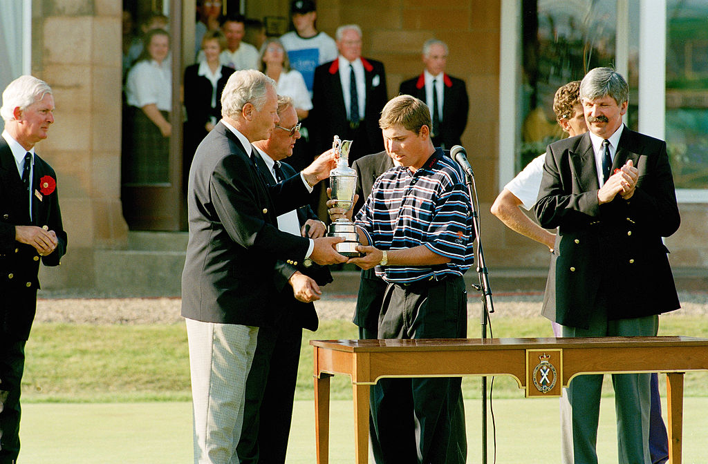 Justin Leonard of the USA receives the Claret Jug after his victory during the 1997 Open Championship.