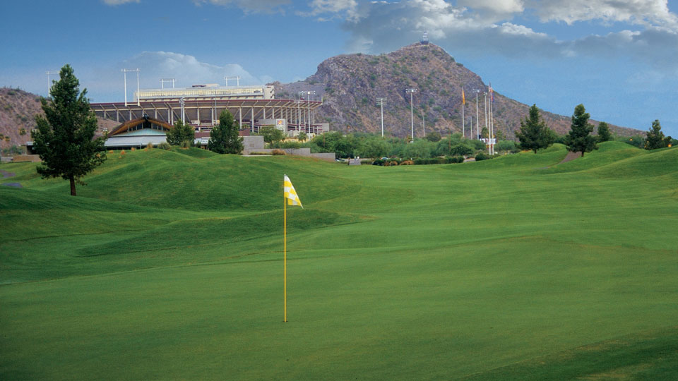 Sun Devil Stadium is visible from the fairway at Tempe's ASU Karsten Golf Course.