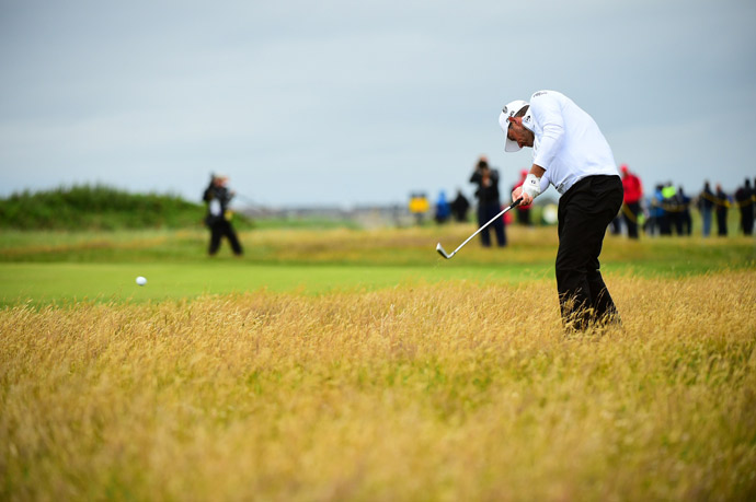 Westwood tries to escape from heather on Friday.
