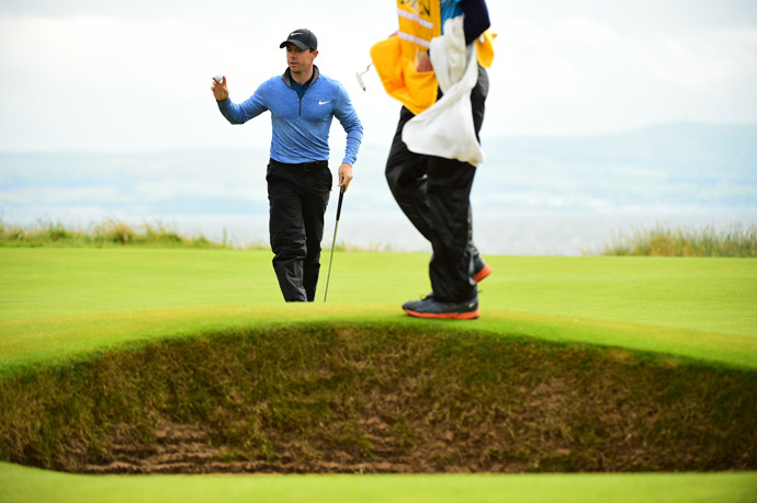 Rory McIlroy tried his best to catch up on Friday in bad conditions.