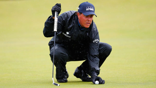 Phil Mickelson mustered four bad-weather birdies on Friday.
