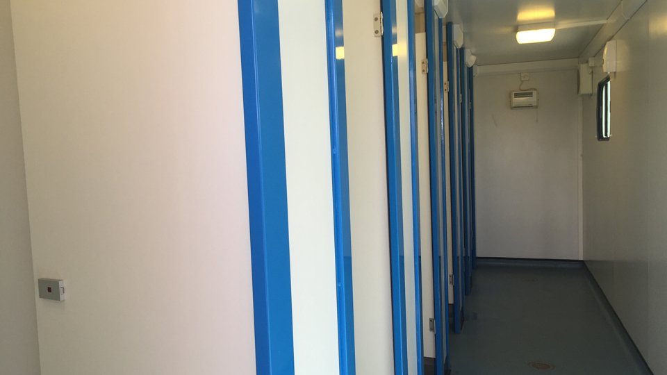 The dormitory-like showers at the Open Camping Village are fitting for college students.