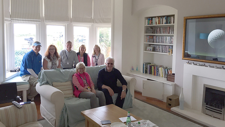 Catherine and Paul Gregory (seated) are hosting the only house party inside the gates of Royal Troon. The guests (from left): Shay McGarr, Cassandra Gregory, Charlie Merchant, Fiona Merchant and Elaine Crummey.