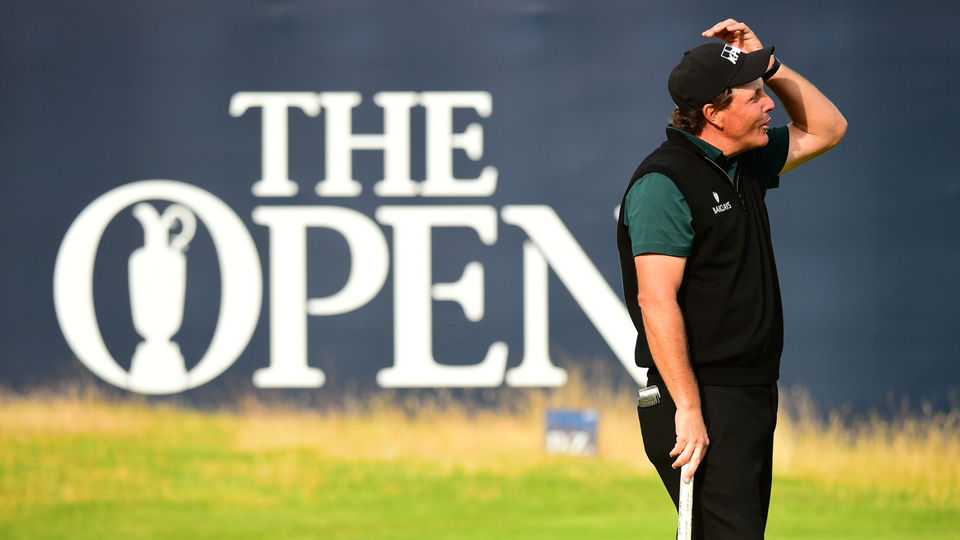 Phil Mickelson reacts after missing a putt for 62 during the first round of the 2016 British Open at Royal Troon.