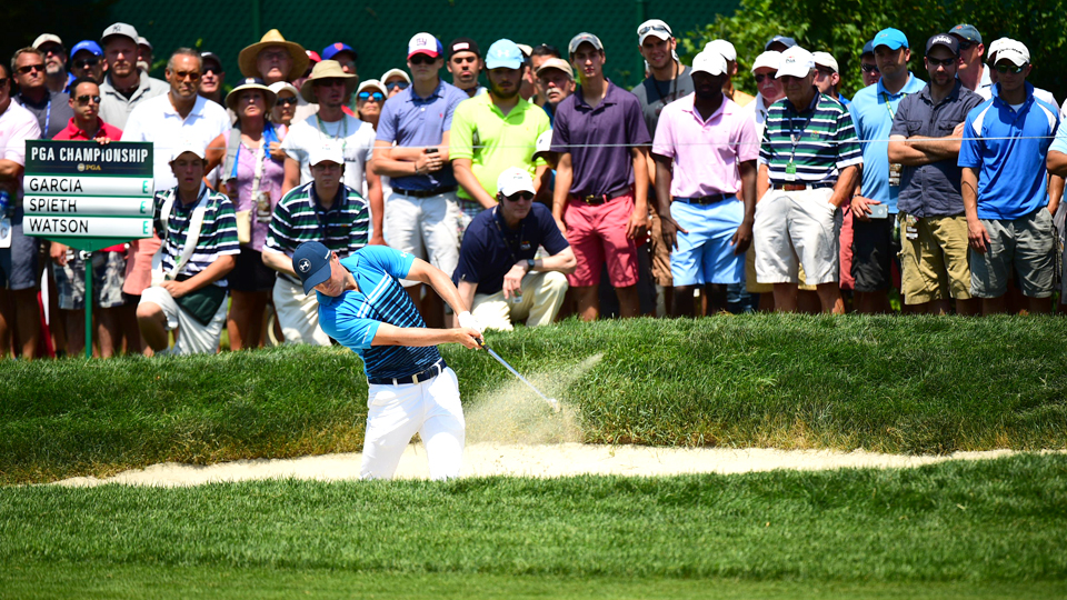 Jordan Spieth blasts out of a bunker during the first round. Spieth is even after his first round and five off the lead.