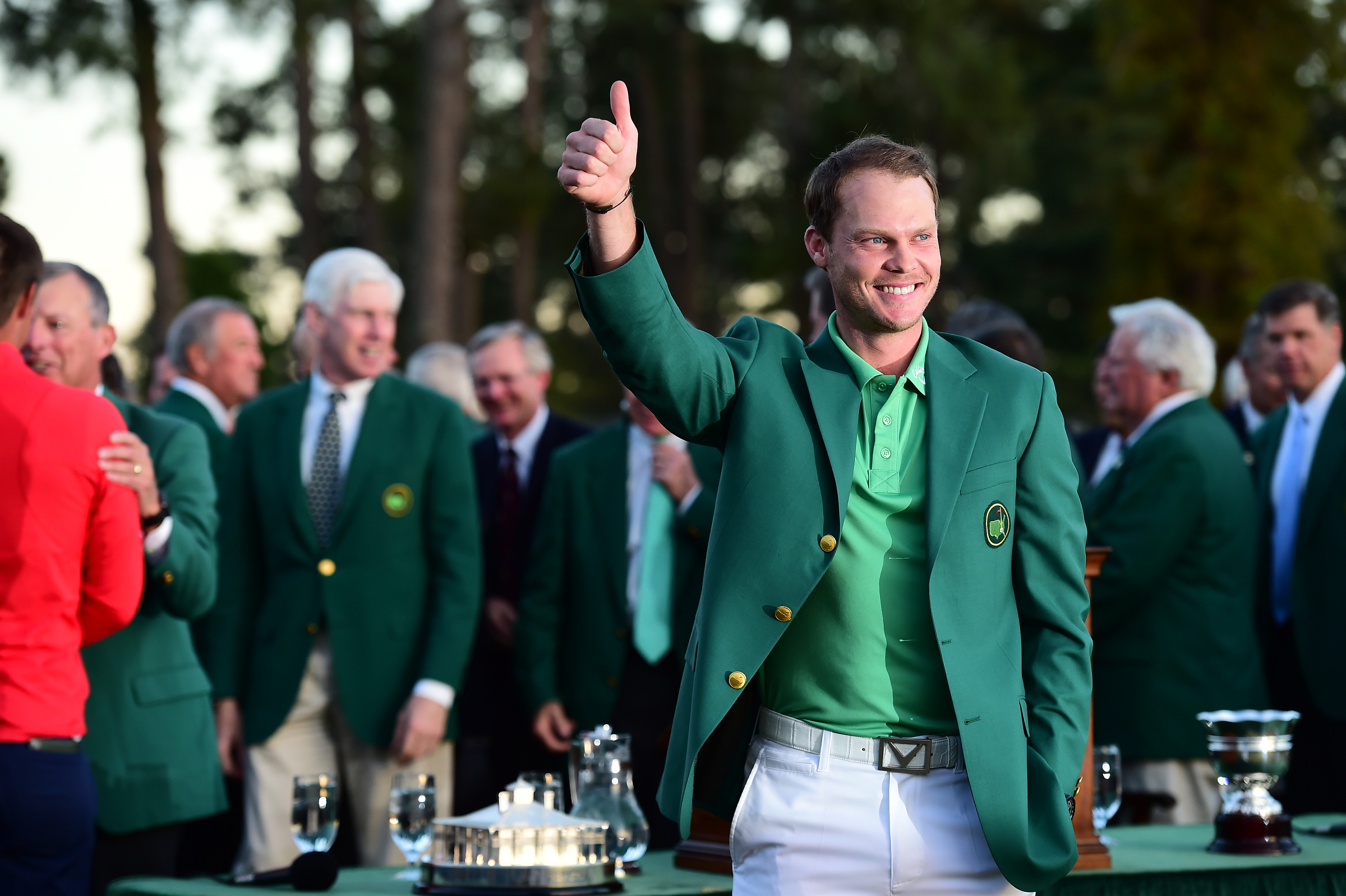 Danny Willett poses for the cameras while wearing the green jacket after winning the 2016 Masters Tournament.