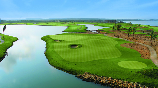 Water's everywhere at TPC Cartagena, including on No. 14.