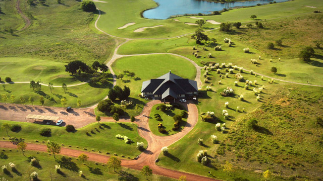 The clubhouse at the Carmelo Resort & Spa is a punch shot from the Rio de la Plata.
