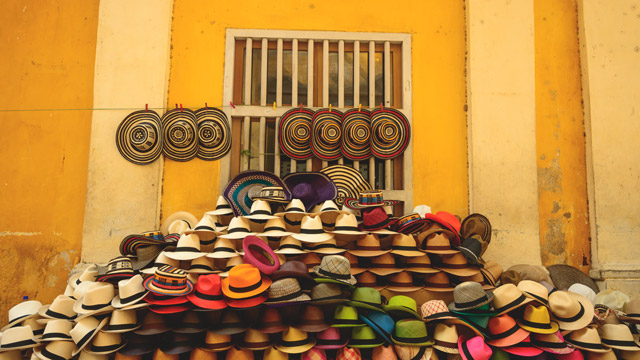 As colorful wares go, nothing tops the hat vendor in Cartagena's airy marketplace.