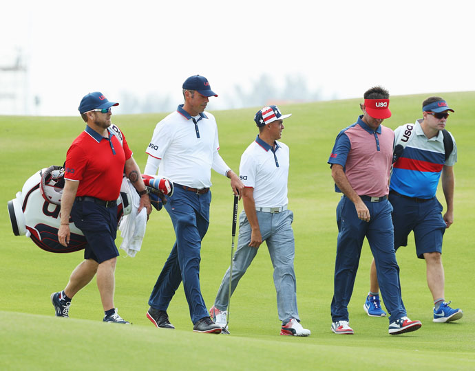The United States's Matt Kuchar (second from left), Rickie Fowler (middle) and Bubba Watson (second from right)